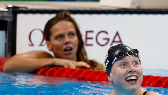 Lilly King of the United States celebrates winning gold in the Women's 100m Breaststroke Final on Day 3 of the Rio 2016 Olympic Games at the Olympic Aquatics Stadium on August 8, 2016 in Rio de Janeiro, Brazil.
