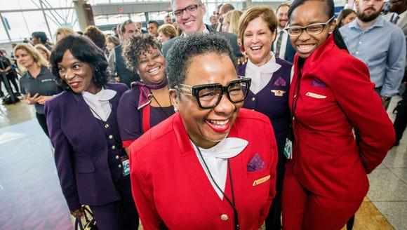 "Delta employees pose at an Atlanta ""fashion show"" ahead"