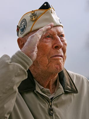 John Walton, a life-long resident of Paterson, N.J., and Pearl Harbor survivor, salutes during a Veterans Day service on Nov. 11. Walton, who served in the Navy and Air Force during WWII, turned 100 years old on Dec. 1.