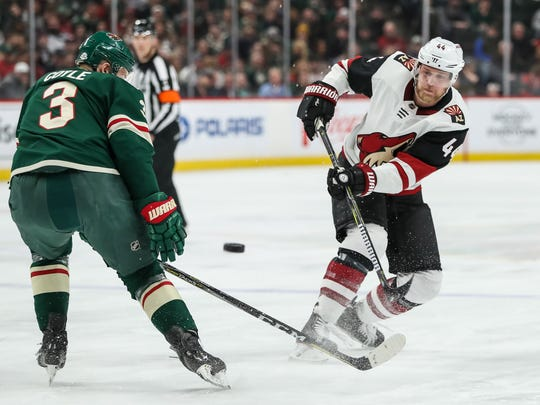 Arizona Coyotes defenseman Kevin Connauton (44) shoots around Minnesota Wild forward Charlie Coyle (3) last season.