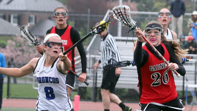 Bronxville's Ellie Walsh gets the ball ahead of Rye's Caroline Neave during a girls varsity lacrosse game at Bronxville High School April 26, 2016. Bronxville defeated Rye 15-5.