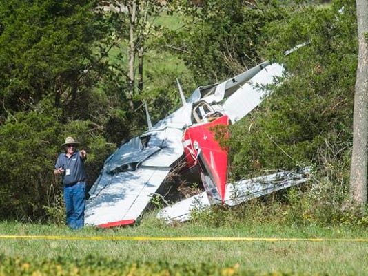 A Federal Aviation Administration investigator works at the scene of a Cessna crash in Cumberland Township, just outside Gettysburg, on Saturday. Two people were in the plane and at least one was seriously injured, officials said.