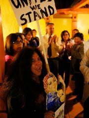Olga Reyna, a special education paraeducator at John E. Steinbeck Elementary School in Salinas, celebrates the election of Estrella Thoeni into the Alisal Union School District Board of Trustees on Tuesday night at Taquitos Mexican Restaurant in Salinas.