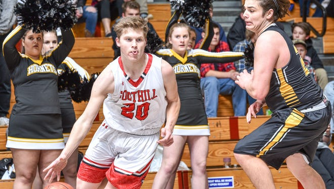 Foothill High's Carter Smith dribbles past Enterprise's Mitchell Stahl on Friday night in a Northern Section Division III quarterfinal game. Smith scored 21 points in the 56-48 win.