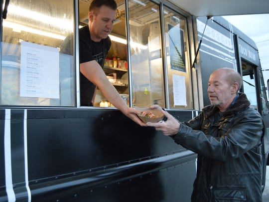 Billy Lucus, owner of Taco Reho food truck, serves