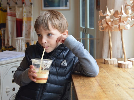 Colson Moore, 4, enjoys a fresh fruit smoothie from Nectar Cafe and Juice Bar in Lewes.