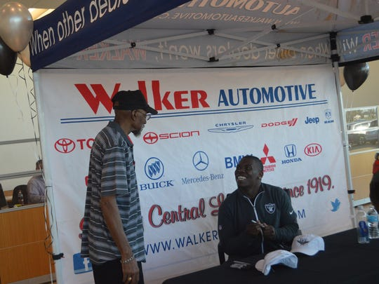 Oakland Raiders running back Jalen Richard chats with a fan while signing autographs at Walker BMW Jan. 24.
