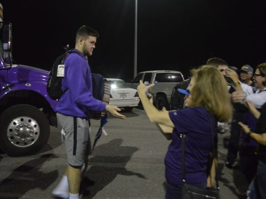 LSUA senior Gilbert Talbot (left) greets with Generals fans Tuesday.