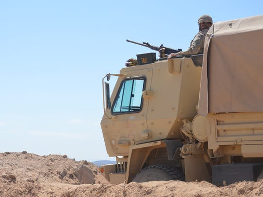 A soldier with the 127th Aviation Support Battalion mans an M2 .50 caliber machine gun from the turret of a Light Medium Tactical Vehicle during a recent exercise.
