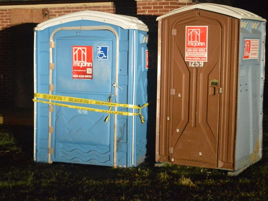 Wilmington police seal off a Kirkwood Park portable toilet where a woman was found stabbed to death. The homicide is Wilmington's 27th of the year.