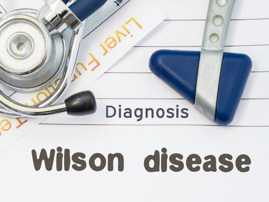 Diagnosis Wilson Disease. Neurological hammer, stethoscope and liver laboratory test lie on note with title of Wilson Disease. Concept for neurology and gastroenterology