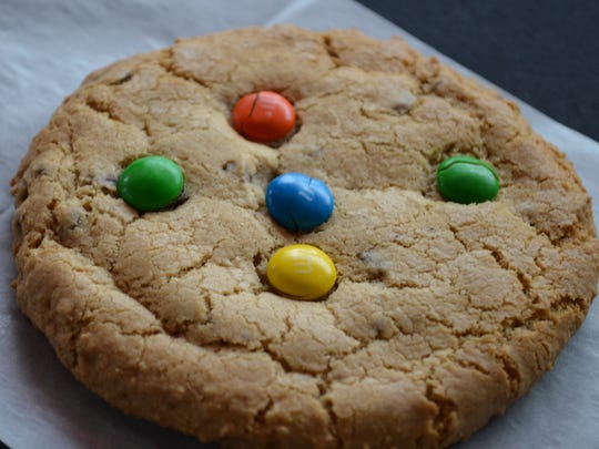 Jennifer Clark, owner of Jen's Sweet Treats, learned how to put M&M's on cookies at the age of 3.