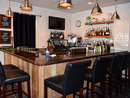 Lupo Di Mare recently upgraded its bar with wood trim,