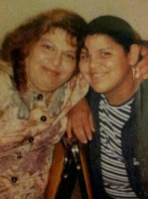 Adriana Velasco poses with her mother Rosie (right). Velasco's mother died of a heart attack in 2011.