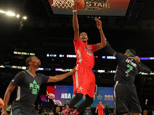 FILE - In this Feb. 16, 2014, file photo, West Team's Kevin Durant heads to the hoop against Team East's Chris Bosh, left, and Carmelo Anthony during the NBA All-Star basketball game in New Orleans. The NBA has decided to hold the 2017 All-Star Game in New Orleans, a person familiar with the decision told The Associated Press. The person spoke to the AP on condition of anonymity Friday, Aug. 19, 2016, because the decision hasn't been announced. New Orleans replaces Charlotte, which was set to host the game until the NBA decided last month that it wouldn't hold its marquee, mid-season event in North Carolina because of a state law that limits anti-discrimination protections for lesbian, gay and transgender people. (AP Photo/Bob Donnan, Pool, File)