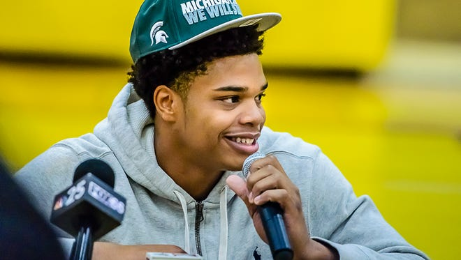 Miles Bridges smiles as he announces that he will attend Michigan State Saturday at Mott Community College in Flint, Michigan.