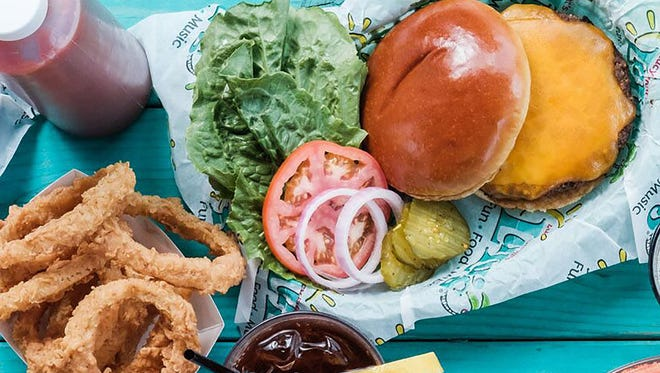 """Lulu's Cheeseburgers in Paradise is half-pound burger seasoned with Lulu's """"salty peppa"""" seasoning served between two buns with cheese, lettuce, tomato, onion and pickles."""