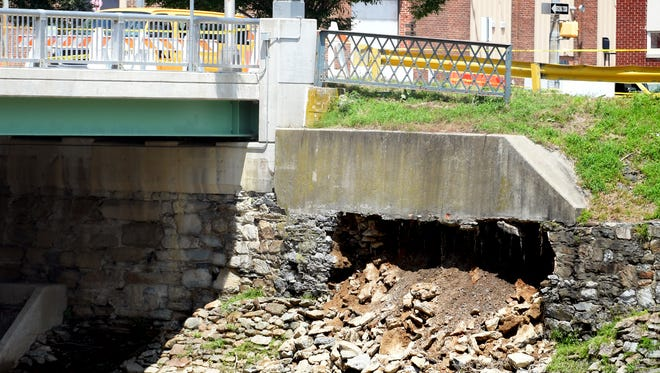 A lane on the Philadelphia Street Bridge was closed after a retaining wall collapsed below it along the Codorus Creek Thursday, July 26, 2018. Bill Kalina photo