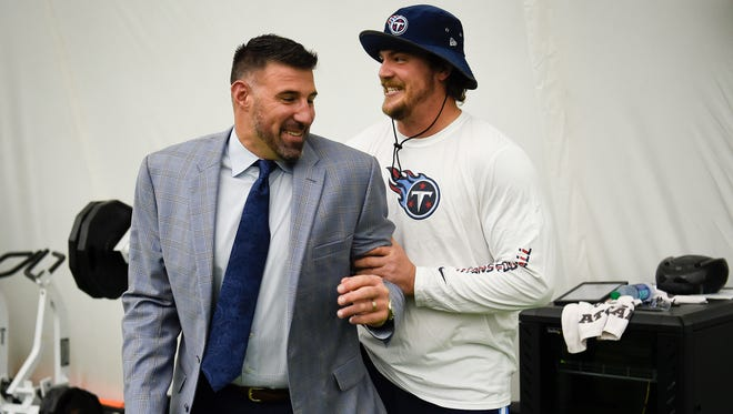 New Titans coach Mike Vrabel, left, jokes around with Titans offensive tackle Taylor Lewan before Vrabel's introductory press conference Monday at Saint Thomas Sports Park.