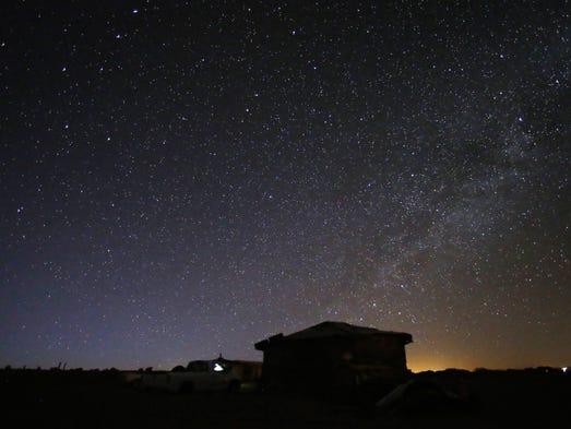 Stars illuminate the June sky over a hogan near Sanders,