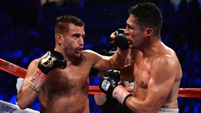 David Lemieux, left, lands a punch against Marco Reyes, right, during their bout at T-Mobile Arena in Las Vegas.