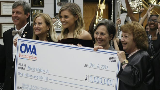 The CMA Foundation has provided Metro Nashville Public Schools and its teachers millions for music education. With this year's CMA Foundation Music Teachers of Excellence award, it is extending its reach past Tennessee and to other states.  In this photo from 2016, former Nashville Mayor Megan Barry, singer Kelsea Ballerini, former Metro Schools Chief of Staff Jana Carlisle and former school board Chair Anna Shepherd pose with a $1 million check from the CMA Foundation.