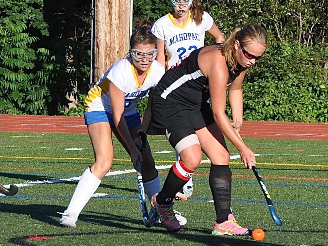Fusine Govaert is about to pass the ball on a backdoor reverse to Kate Stevens, who then scored Rye's fifth and last goal against Mahopac. Photo from Sep 12, 2016