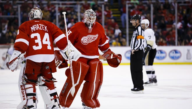 Last season it took two goaltenders — Jimmy Howard, right, and Petr Mrazek — to carry the Red Wings.