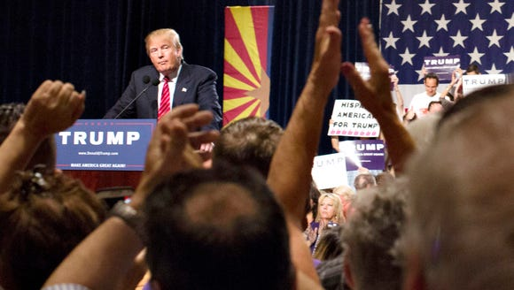 Donald Trump, show here speaking in downtown Phoenix