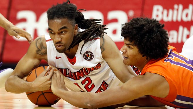 Illinois State's Tony Wills, left, and Evansville's Dru Smith dive after a loose ball during the second half of a Missouri Valley Conference quarterfinal game at the Scottrade Center in St. Louis on Friday. Illinois State won 80-69.