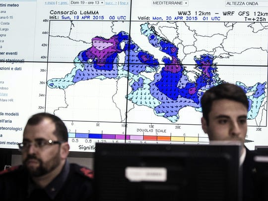 Personnel at work in the operations room of the Italian
