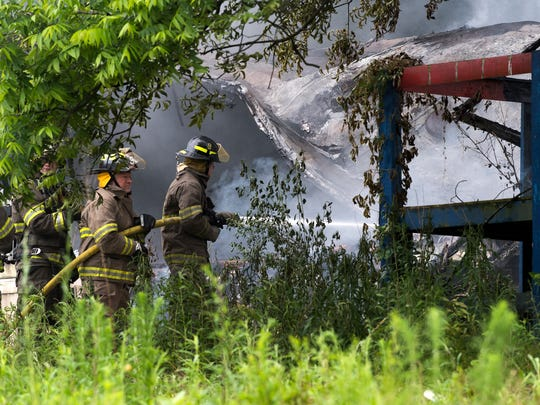 Centerville Volunteer Fire Department firefighters respond to a mobile home fire Tuesday near Appleton and Whitner streets in Anderson.