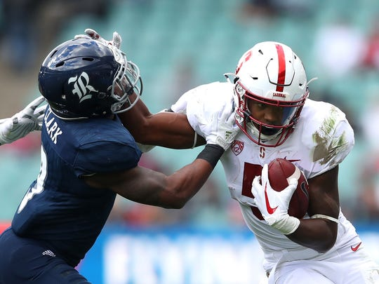 Connor Wedington of Stanford tries to break a tackle during the College Football Sydney Cup match between Stanford University  and Rice University at Allianz Stadium in Sydney, Australia.