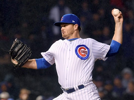 Cubs reliever Justin Wilson pitches in the ninth inning during Game 4 of the National League Division Series against the Washington Nationals at Wrigley Field on Oct. 11, 2017 in Chicago.