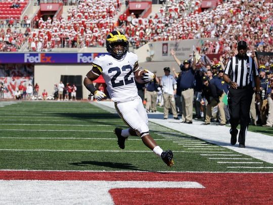 Michigan's Karan Higdon scores a 12-yard touchdown in the first half against Indiana in Bloomington, Ind., Saturday, Oct. 14, 2017.