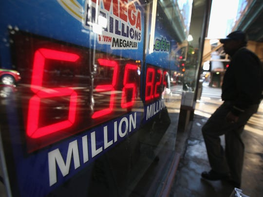 A sign in Chicago advertises a $636 million Mega Millions