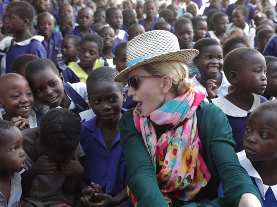 Madonna chats with children in Kasungu, about 90 miles