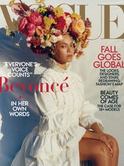 Beyonce wears a white Gucci dress and floral headdress