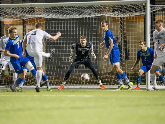 UD goalie Todd Morton eyes a shot by Providence's Steven KIlday.