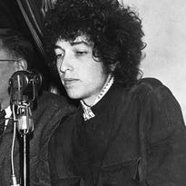 Bob Dylan gestures during a press conference in Paris on May 22, 1966. Dylan's tumble from his Triumph in Woodstock, N.Y., 50 years ago on July 29, 1966, was the most analyzed motorcycle crash in pop-culture history. But for all its importance, details surrounding the crash remain foggy.