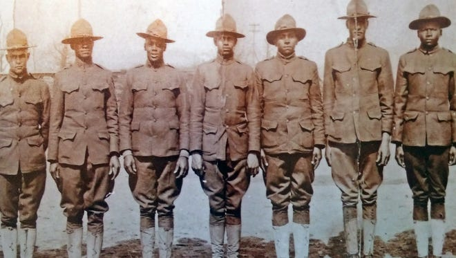 African-American doughboys from Hampton Institute were getting ready to head off to war in this photograph. Harry Smith, who according to family story, shod Gen. Pershing's horse, is the third man from the left.
