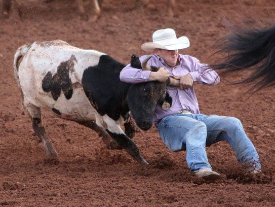 Zach Peterson competes in steer wrestling Saturday,