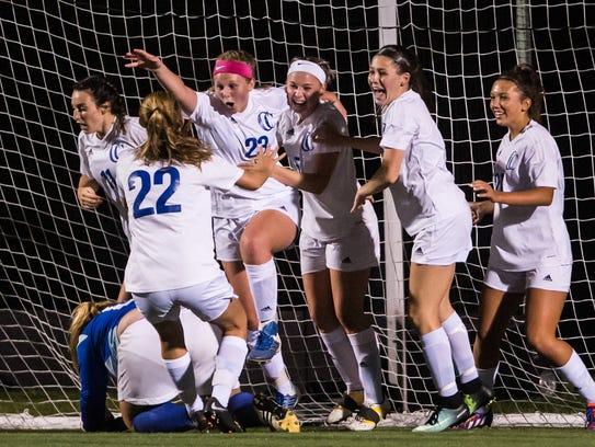 Cedar Crest's Tori Roberts (23) celebrates her goal