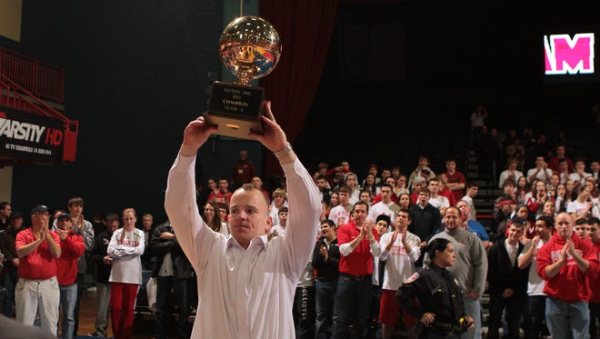 Tappan Zee coach George Gaine hoists the gold ball following the Tappan Zee's 50-45 win over Poughkeepsie in the Section 1 Class A championship. The championship was played Sunday at the Westchester County Center in White Plains.  Matthew Brown/The Journal News Tappan Zee coach George Gaine hoists the gold ball following their 50-54 win over Poughkeepsie in the 2012 Section 1 Class A championship at the Westchester County Center in White Plains March 4, 2012.