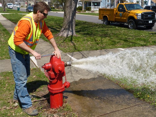 Crews from Middlesex Water Co. and N.J. American Water Co. working in the Edison neighborhoods they each serve to conduct routine hydrant flushing.