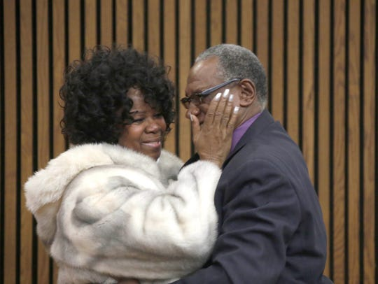 Joyce Holman embraces her brother Bernard Young Tuesday Dec. 13, 2017.