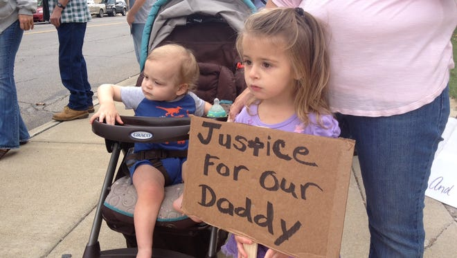 Brian Garber's two children, Holly, 4, and Nick, 16 months, were among the supporters at Thursday's protest.