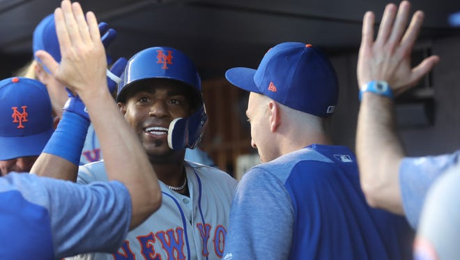 Yoenis Cespedes enters the Mets dugout after hitting a solo home run in the third inning against the Yankees on Friday, July 20, 2018 at Yankee Stadium.