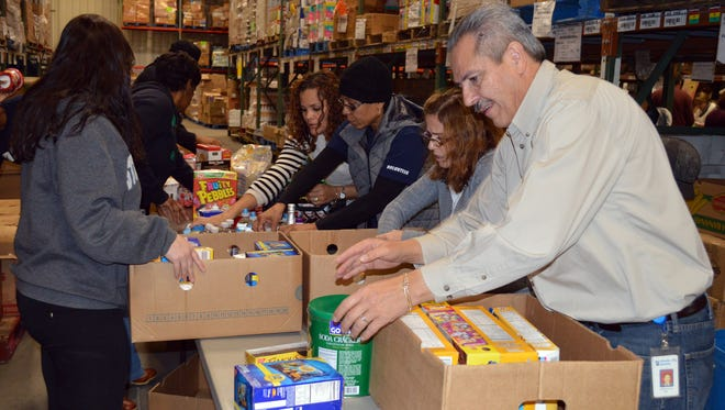Atlantic City Electric employees, family members and friends volunteer at Community FoodBank of New Jersey, Southern Branch, in Egg Harbor Township.