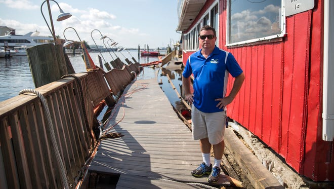 Captain Harry Julian, a founder of Pure Florida boat tours, stands by one of his docks on Tuesday, Sept. 19, 2017, that was left destroyed by Hurricane Irma at Tin City, a popular spot for tourists. The business also sustained damage to its water vessels.